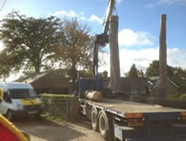 Using hiab to dismantle, lift & remove large pine stems from site in Great Ayton